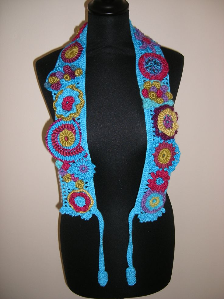This is a neck piece I designed last year.  It is a great way to show all the different designs of crocheted flowers.  It could also be worn as a belt.