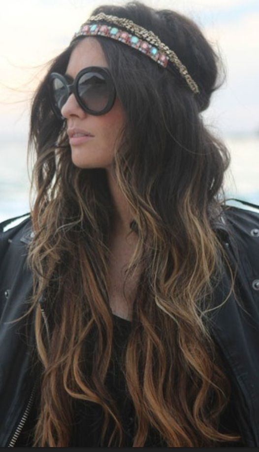 Boho/hippie chick with ombre wavy hair, headband/headpiece, and oversized black sunglasses. Very cochella.