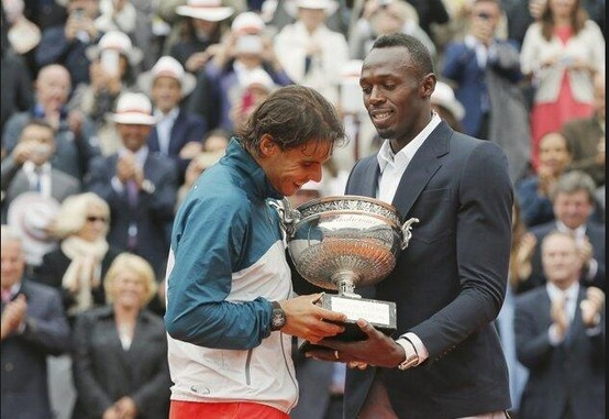 Winning his 8th French Open, Rafa Nadal accepts the trophy at Roland Garros from Ussain Bolt!