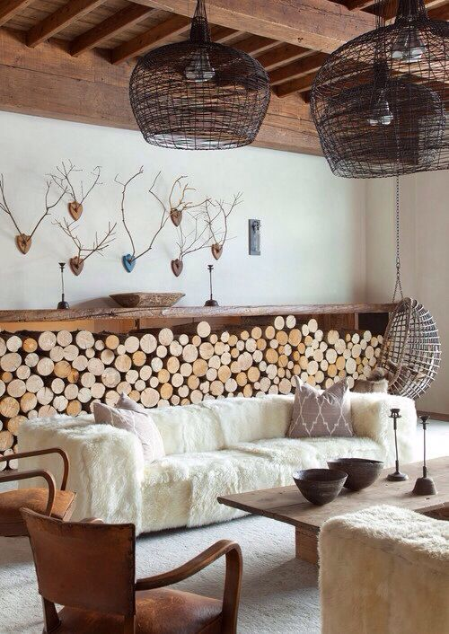 ski lodge chic - Love the wall of wood logs & leather chairs!