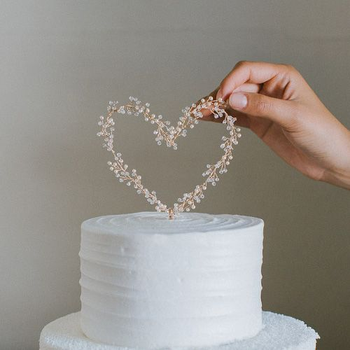 Inspired by heart sparklers, it's very festive and elegant. Made with gold wired pearls and crystals attached to a kraft wire for the heart post. NOTES: Each cake topper are …