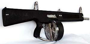 AA-12 drum fed shotgun-machinegun. Recoil-less. 12 gauge. The end all for shotguns.