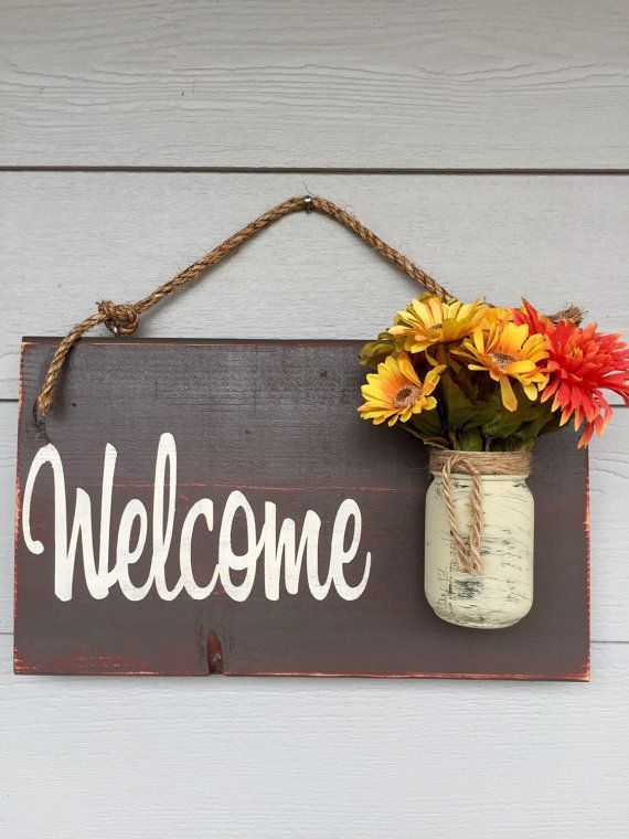 Size is approximately 12 X 18 inches. Depth is approximately 5 with the Mason jar. - Comes ready to hang - Light sealer applied - New wood used -Flowers NOT included - Custom font color (you pick)  FONT COLORS: Tan, White, Yellow, Teal, Barn Red, Dark Red (Maroon), or a light green.  ***Dont forget to list your font color in the note to seller area when placing your order. If there is not a color listed thenI will use white as shown. If you would like a different word other than Welcome…