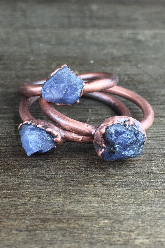 Find more Rough & Precious treasures: https://www.etsy.com/shop/ROUGHandPRECIOUS?ref=seller-platform-mcnav  Listing is for >one< sapphire copper ring.  Raw sapphire ring / Blue sapphire ring / Rough gemstone ring / Raw gemstone / gift for her / September birthstone ring / Genuine sapphire  One beautiful, raw sapphire, electroformed in copper on a solid copper band. The copper is patinated to a beautiful antique copper finish and...