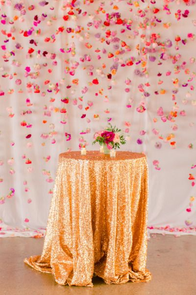 Sequin tablecloth and a hanging flower backdrop: http://www.stylemepretty.com/2014/11/10/whimsical-dallas-loft-wedding/ | Photography: N. Barrett - http://nbarrettphotography.com/