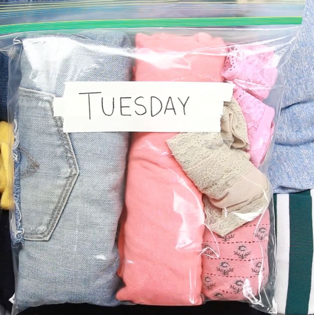 This may be a little OCD, but it is so up my alley!!! Organize outfits or accessories by day in resealable plastic bags. | Make Traveling Stress-Free With These Space-Saving Packing Hacks