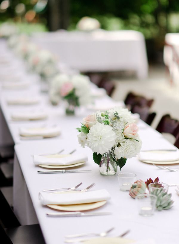 Gorgeous white, green, and light pink centerpieces at long tables!  Love the fullness of the flowers!