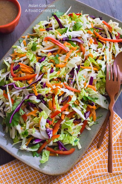 Cool, crunchy and healthy - Asian coleslaw with a creamy almond butter dressing instead of the usual mayo. Party on a platter!