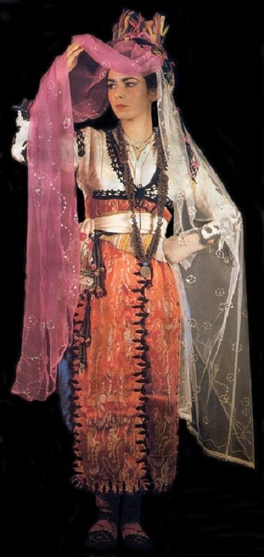 Traditional bridal dress from the village of Ibecik (near Gölhisar, in the southwest of the Burdur province).  Clothing style: 1950-1975.  This kind of costume is still worn (2010s) by young women during wedding festivities.  Picture source: page 55 of 'Tarihi Türk Kadın Kıyafetleri', printed in Istanbul, 1986.