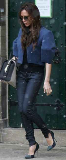 Victoria Beckham: Shoes – Proenza Schouler    Jacket – Balenciaga    Purse – Victoria Beckham Collection