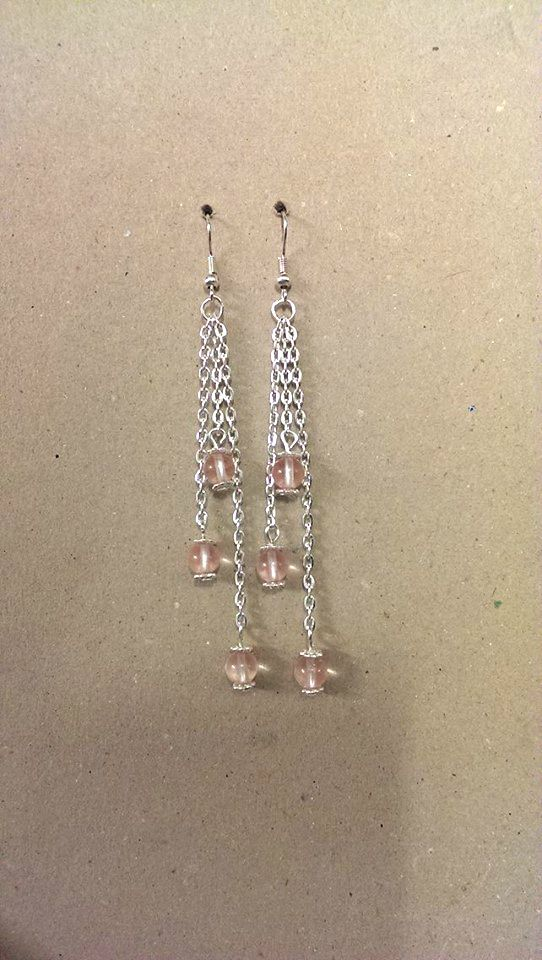 A pair of Clear Rose Quartz Earrings with chain and daisy spacer beads.