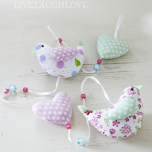 Pretty hanging padded fabric heart and birds garland hanging from white satin ribbon with little coloured glass beads. Very long at H95cm W9cm D5cm.  £9.95