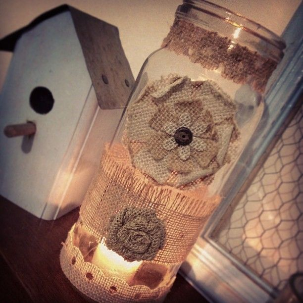 A decorated Fowlers preserving jar used as a candle holder.