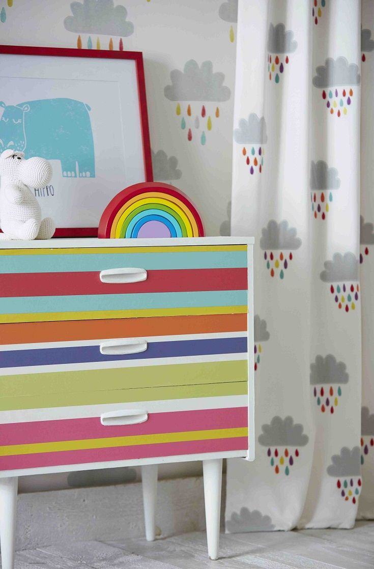 Appliqued little grey clouds with multi coloured raindrops, on a cream background create a pretty effect fabric.