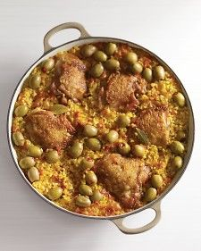 Arroz con Pollo - The bold flavors of saffron, bay leaves, and garlic infuse Valencia rice, a Spanish variety perfect for slow-cooked dishes (it is the traditional base for paella). Here, the grains are cooked up with golden-brown chicken thighs and garnished with pimiento-stuffed olives. Saffron gives the rice its warm yellow hue.