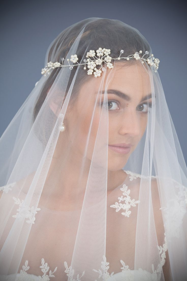 Subtle Hair Accessory made with Swarovski®️Crystal & Pearl shown here over a veil.                                              Hair Accessory : Cherrywood Designs // Veil & Gown : Erin Clare Couture // Photo : Blue Fish Imaging  //