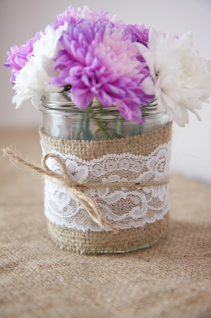 This is what I think I am going to do for my main centerpieces! Mason jar wrapped in burlap with wildflowers. Then I plan on having small mason jars wrapped in lace with candles.