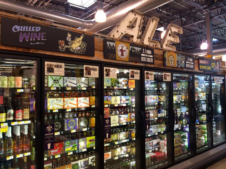 beer retail signage cooler gas station inside cave shelving dying rescue