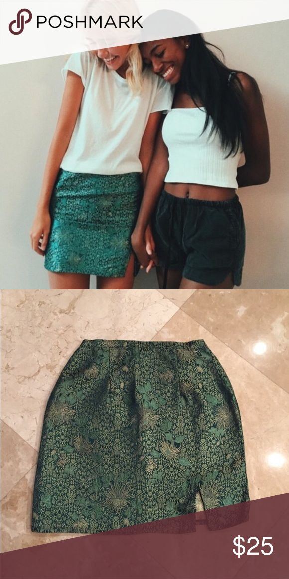 """NWT Green Silky Moss Skirt Never worn before and still has tags attached. Has an elasticized waist and a hidden zipper enclosure. Would fit an XS-S or a 24-26 waist. 15"""" in length and 11.5"""" waist laid flat but will stretch because of elastic band. Brandy Melville Skirts Mini"""