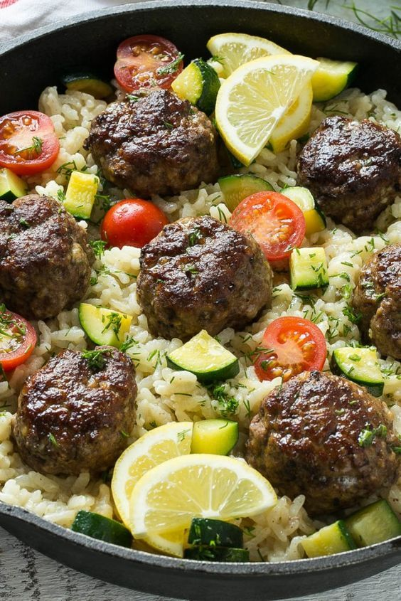 This recipe for one pot greek meatballs with lemon dill rice includes savory greek spiced beef meatballs, creamy arborio rice and vegetables, all cooked together in a single pot! #VillageHarvestInspired: