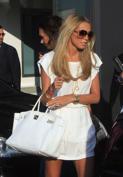 Petra Ecclestone in a little white dress.
