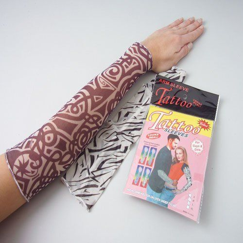 """One Pair Fake Tattoo Sleeves by US Toy Company. $14.99. One pair of tattoo sleeves. Dress up your rocker look with these realistic looking tattoo sleeves.  Tattoo sleeves are made of mesh cloth.  Size 15 L."""""""