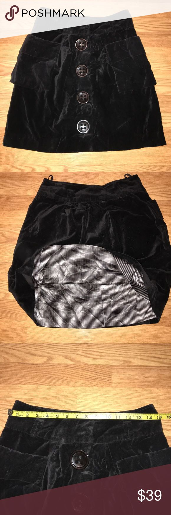 Anthropologie Elevenses Black Velvet Skirt Size 6 -excellent preowned condition -fully lined -large button detail of the front -two large front pockets -Supersoft luxe black velvet Bundle up; offers always welcome! Anthropologie Skirts Midi