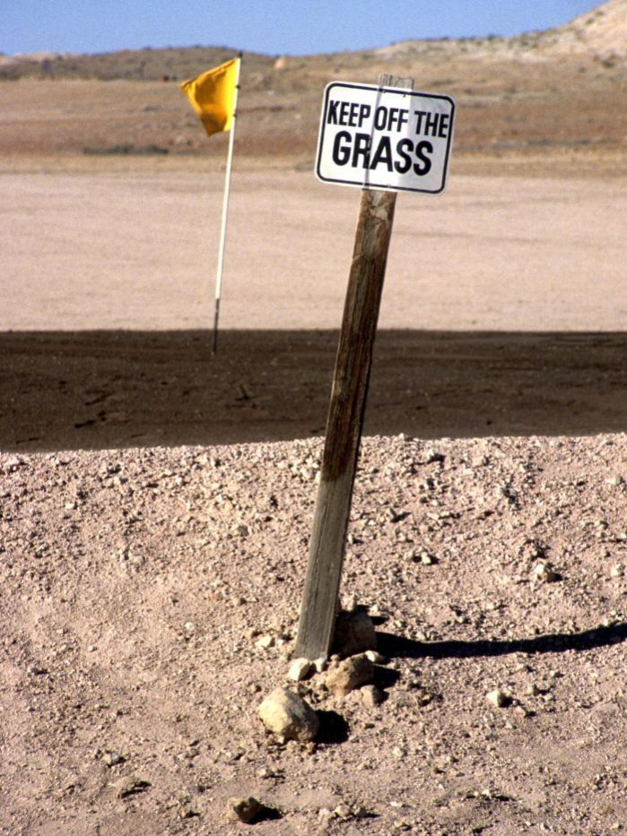 Coober Pedy - keep off the grass Those Australians have such a sense of humor :)