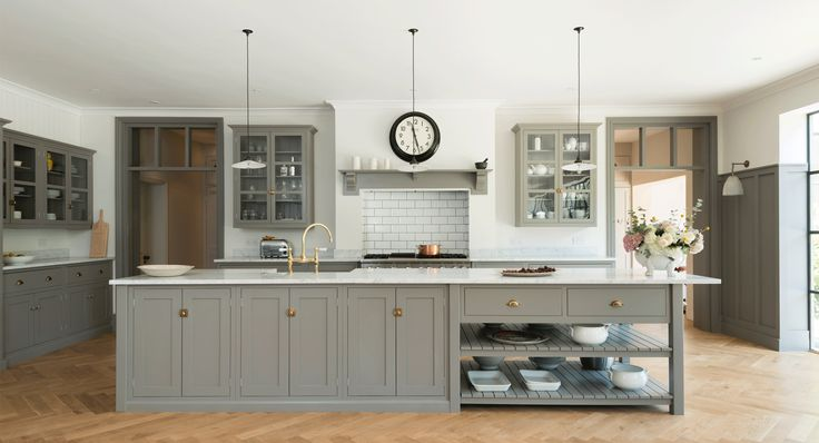 Note- the architectural points of the room tied to cabinets and unified by colour.Shaker Kitchens by deVOL - Handmade Painted English Kitchens