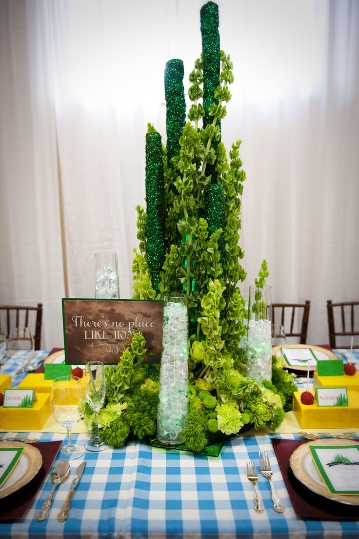 Jasmine created a floral Emerald City centrepiece for a Wizard of Oz themed table. www.reflectionsweddings.ca