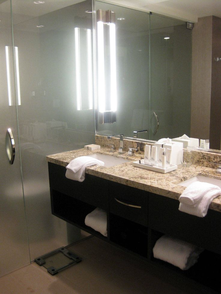 25 best images about bathroom vanities on pinterest for Black glass bathroom accessories