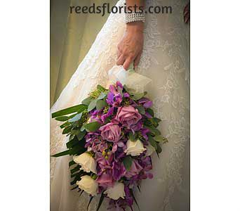 Elegant purple and white bouquet designed for our bride to compliment her perfect dress. Available exclusively with our highly experienced designers. reedsflorists.com