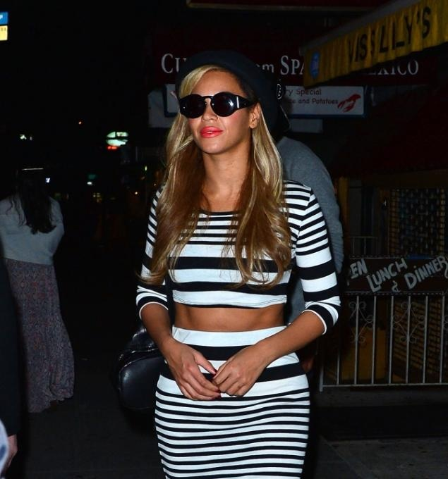 Beyonce shows a little skin leaving Miss Lily's restaurant, where Kanye West celebrated his 36th birthday with several of his famous friends.