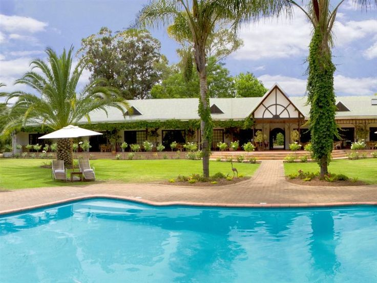 Hlangana Lodge - Hlangana Lodge is Oudtshoorn's premier destination.  This highly recommended lodge offers individually decorated en-suite rooms which are equipped with queen-size beds or twin beds, TVs, minibars, safes, ... #weekendgetaways #oudtshoorn #southafrica