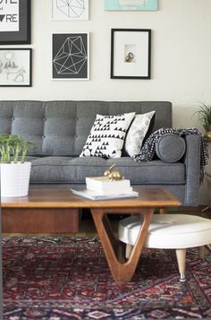 Charcoal couch with carpet; coffee table WONT be wood, it just emphasizes how the rug would interact with a wood floor of that color