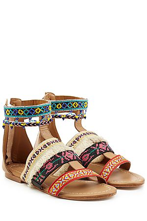 One of the original founders of Antik Batik, Christophe Sauvat taps into eclectic bohemian style and adds a fun, lively twist. Made from buttery leather and embellished with multicolored beads and fabric, this pair of sandals are a statement choice for hot weather style #Stylebop More