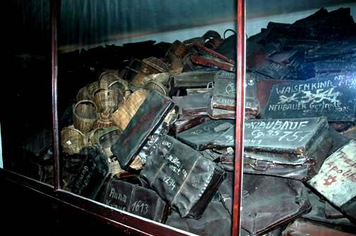 Suitcases carried by the victims of the Holocaust. They were often labeled with the names and numbers of the carriers. Unlike the shoes, they show little sign of deterioration. Rooms were also stacked with these, among other containers.