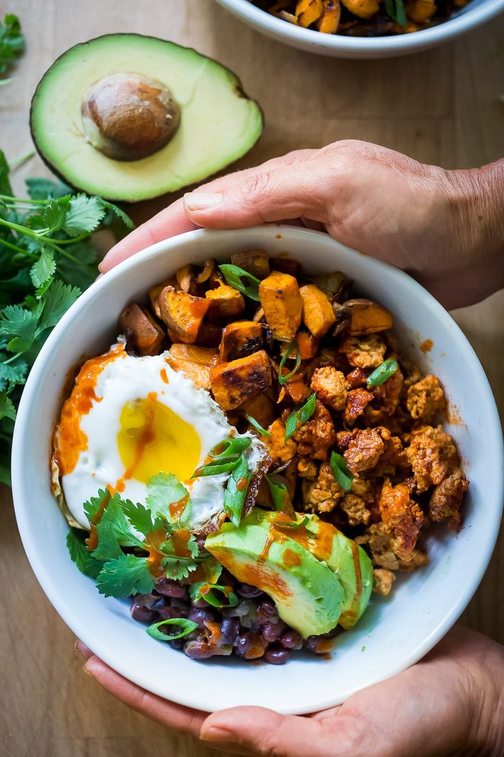 Mexican Breakfast Bowls with sweet potatoes, blackbeans, turkey chorizo ( optional) avocado, cilantro and an egg. Healthy yummy!  | www.feastingathome.com