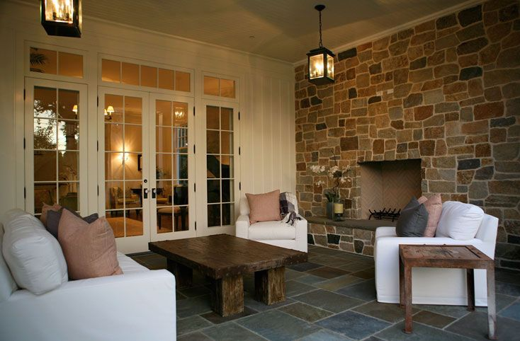 decks/patios - stone fireplace oil-rubbed bronze lanterns slipcovered slip-covered slipcovers slip covers white sofa chairs pink gray outdoor throw pillows teak accent tables French doors slate tiles floors veranda patio colors