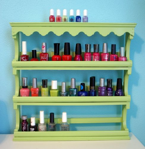 Old fashioned spice rack converted into a nail polish holder. Paint any color to fit your decor. Clever!