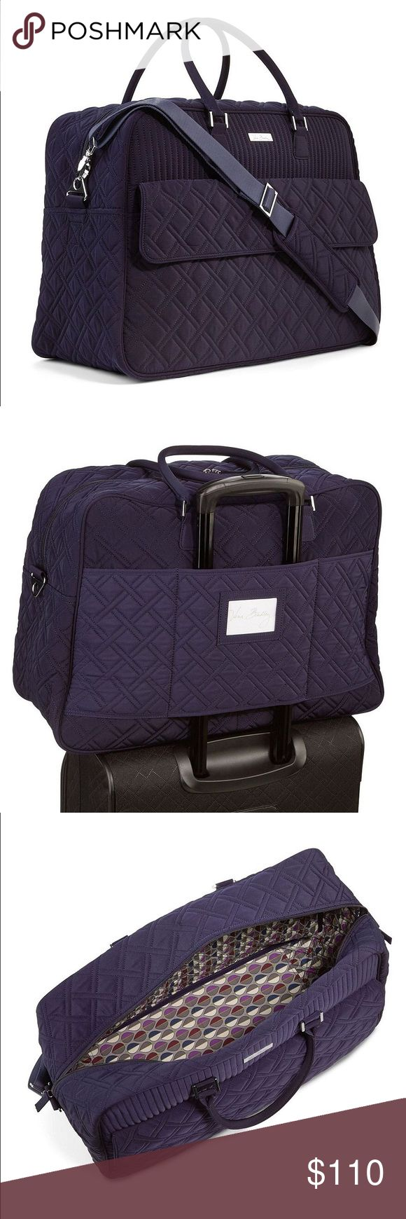 Vera Bradley Grand Traveler Bag Vera Bradley navy/dark blue Grand Traveler bag. This bag was only used once and is in mint condition except for the scuff on the clear plastic on the back of bag as pictures. This is a carry on compliant bag. Has a trolley slip on back to slip onto your roller luggage. Large front pocket with flap and 4 interior pockets. Water resistant microfiber material. Vera Bradley Bags Travel Bags