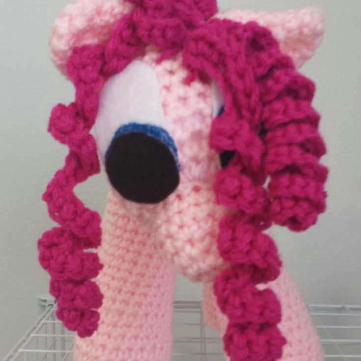 This is the playful party pony Pinkie Pie! She is a special made pony and would love to party or cuddle with you!  This is pony is 17in tall and a great cuddle toy. She is made with a very soft yarn and is perfect for cuddling of all ages.