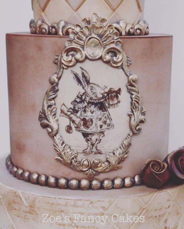 Vintage Alice In Wonderland cake with Hand painted rabbit. The fab moulds are by @marvelousmolds with the gorgeous writing at the base done using @evilcakegenius stencils.  #aliceinwonderland #rabbit #whiterabbit #alice #cake #cakes #handmade #paint #zoesfancycakes #zfc #stencil #vintage #gorgeous #pretty #creative #art #cakeart