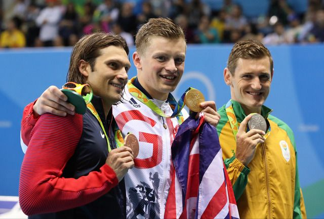 Cody Miller, Adam Peaty and Cameron Van Der Burgh hold up their medals after the final of the men's 100m breaststroke.