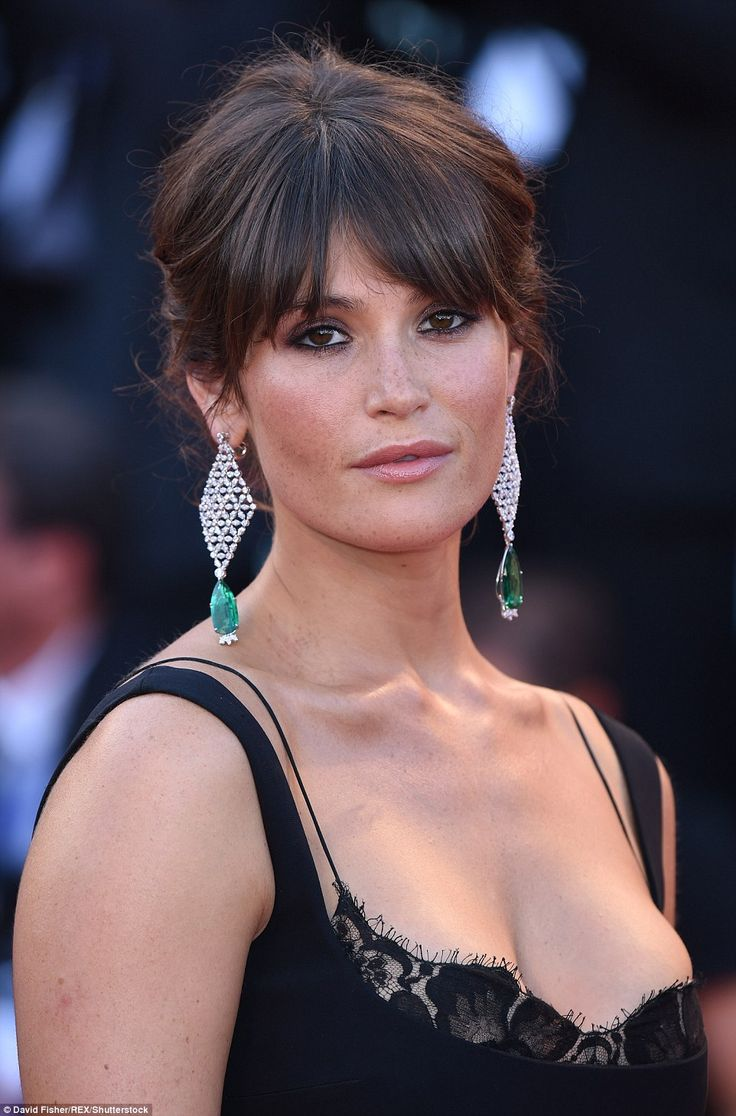 British beauty: Joining Emma at the premiere was British beauty Gemma Arterton, who wore her deep brunette tresses  pinned atop her head while her eye-tickling fringe sat above her smokey gaze