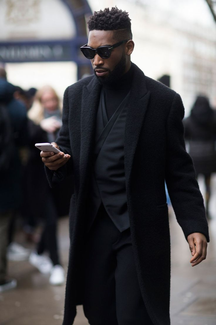 Tinie Tempah looks sleek in dark hues as he enters the Topman Design show on Friday. .January 2016.