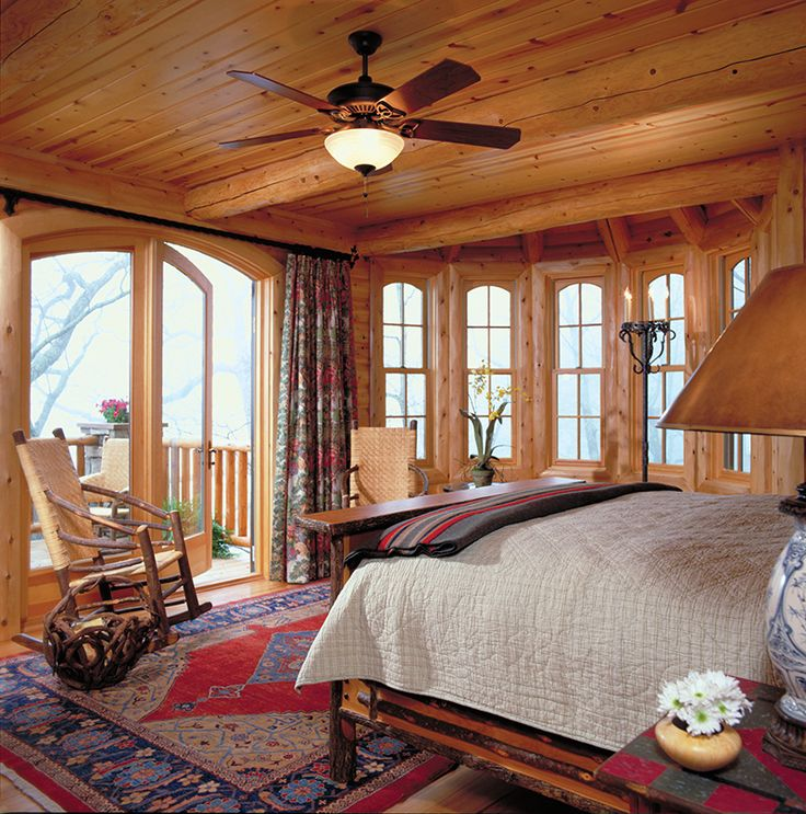 A swinging patio door with outswing operation opens this bedroom up to the outdoors. Heritage Series double hungs with square-out, segment-in top sash let light in from every angle.