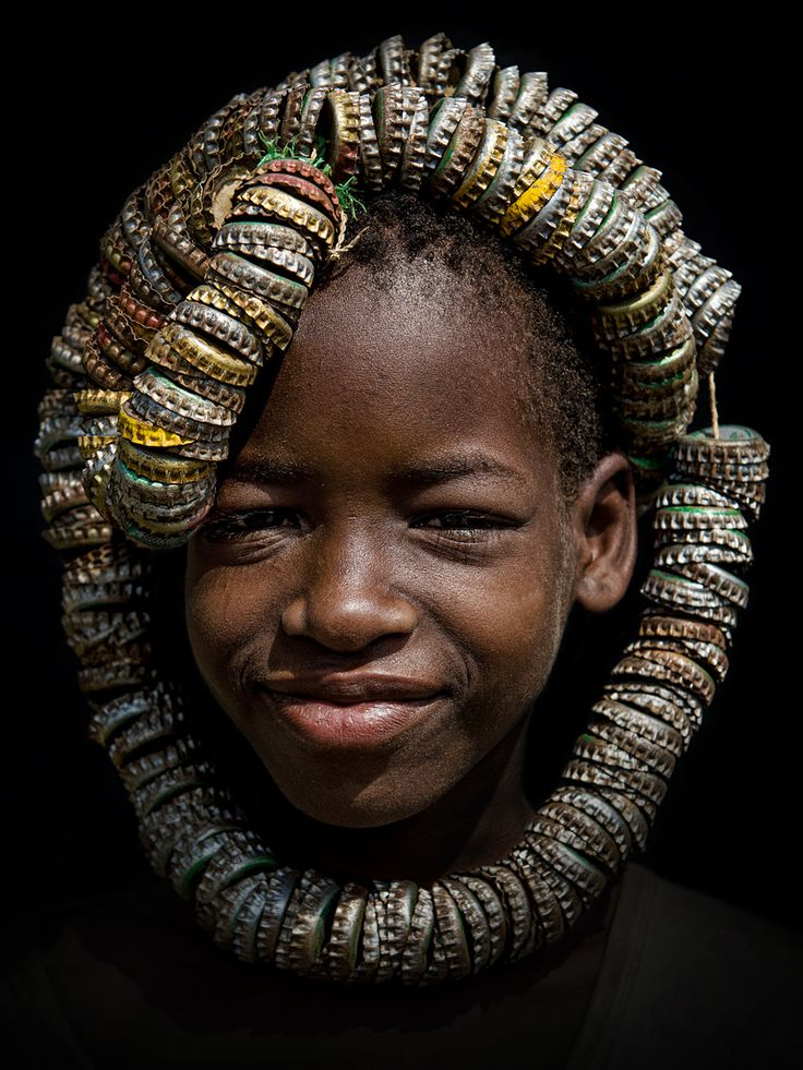 Bottle caps headdress - The first tribe we visited in the Omo valley in southern Ethiopia were the Tsemai/Tsemay/Tsamai near the town of Weyto. They are farmers and pastoralists and the Tsemai women wear clothing made from leather and sometimes a squash hat.     This girl created a unique bottle caps headdress.    This photo has been published in the catalogue of the international Trierenberg photo contest of 2012.