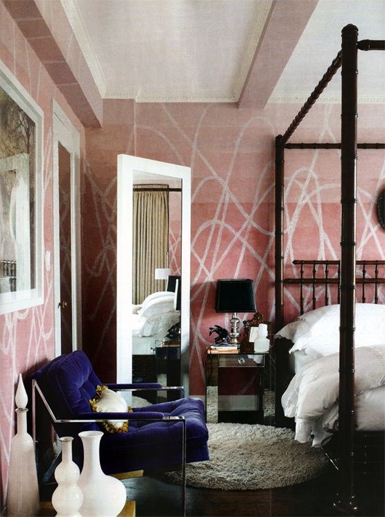 Pink and navy bedroom. Fantastic four poster bamboo bed, midcentury blue velvet chairs and mirrored nightstands.