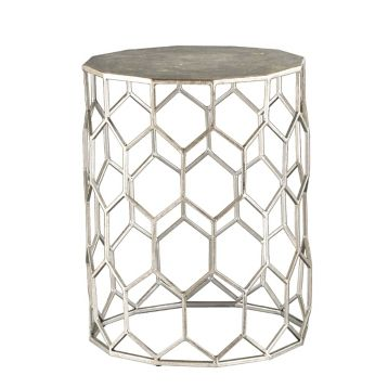 Our Anietta Silver Metal Accent Table is a modern, chic way of updated your living room décor. With a bold silver style, it's the perfect accent table for your home.